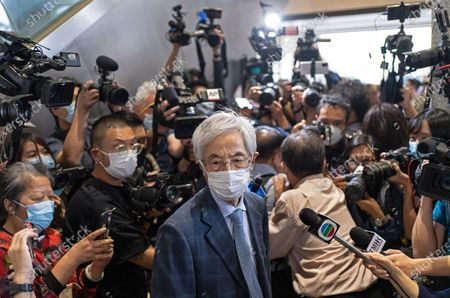 Pro-democracy activist Martin Lee, center, walks out from a court after receiving a suspended sentence in Hong Kong, . A Hong Kong court on Friday sentenced five leading pro-democracy advocates, including media tycoon Jimmy Lai, to up to 18 months in prison for organizing a march during the 2019 anti-government protests that triggered an overwhelming crackdown from Beijing. A total of nine advocates were given jail terms, but four of them, including 82-year-old Lee, had their sentences suspended after their age and accomplishments were taken into consideration