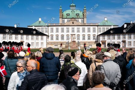 People gather to greet Queen Margrethe II of Denmark outside Fredensborg Castle, Denmark, 16 April 2021. Queen Margrethe celebrates her 81st birthday on 16 April but public appearences had been cancelled due to the COVID-19 pandemic. The Danish monarch instead came to the outside and waved to people who had decided to pass by her castle. Same as last year the celebrations on her birth anniversary will be small, private and will take place at Fredensborg Castle.