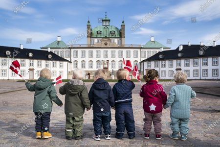 A group of toddlers waves small Danish flags as they gather to greet Queen Margrethe II of Denmark outside Fredensborg Castle, Denmark, 16 April 2021. Queen Margrethe celebrates her 81st birthday on 16 April but public appearences had been cancelled due to the COVID-19 pandemic. The Danish monarch instead came to the outside and waved to people who had decided to pass by her castle. Same as last year the celebrations on her birth anniversary will be small, private and will take place at Fredensborg Castle.