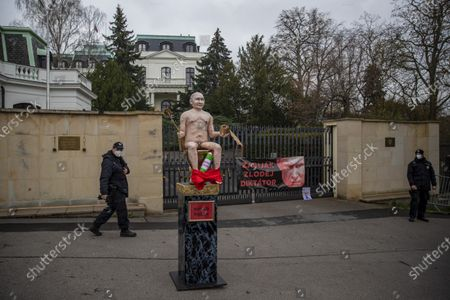 A pedestal with naked statue of Russian President Vladimir Putin sitting on golden toilet bowl as part of a small protest in front of Russian embassy, in Prague, Czech Republic, 16 April 2021. A few activists placed a pedestal in front of the building of Russian embassy as they protested against the imprisonment of Russian opposition leader and blogger Alexei Navalny, human rights abuses in Russia and Russian aggression against Ukraine.