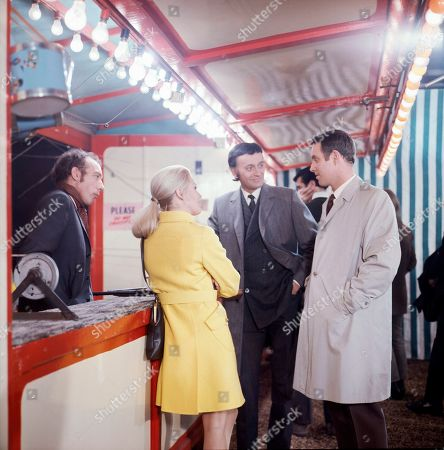 Fairground Concessionaire, as played by Ron Pember, Jeannie Hopkirk, as played by Annette Andre, Emil Cavallo-Smith, as played by Barrie Ingham, and Police Sergeant Bodyguard, as played by Richard Owens