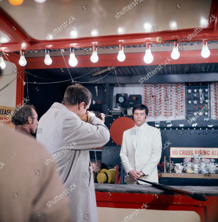 Fairground Concessionaire, as played by Ron Pember, Police Sergeant Bodyguard, as played by Richard Owens, and Marty Hopkirk, as played by Kenneth Cope