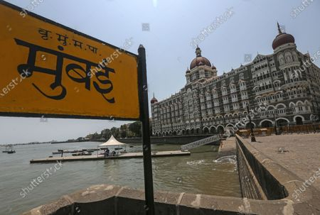 Stock Photo of A general view of deserted The Taj Mahal Palace hotel, one of the most famous tourist spot, after the curfew imposed to avoid the spread of coronavirus COVID19 disease in Mumbai, India, 16 April 2021. A curfew is announced in Mumbai, and many other states as India recorded its highest daily spike of COVID-19 cases on 14 April with around 200,000 new infections in 24 hours.