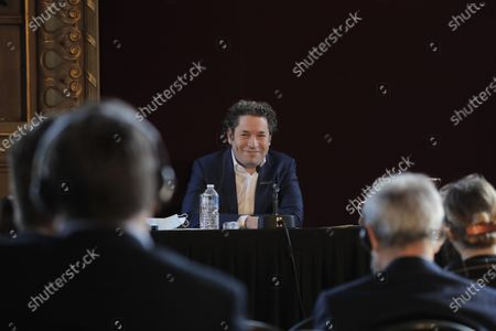 Venezuelan conductor Gustavo Dudamel delivers a press conference at the Palais Garnier opera house, in Paris . The Paris Opera announced the arrival of Gustavo Dudamel as music director for six seasons