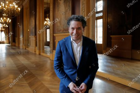 Venezuelan conductor Gustavo Dudamel poses after a press conference at the Palais Garnier opera house, in Paris . The Paris Opera announced the arrival of Gustavo Dudamel as music director for six seasons