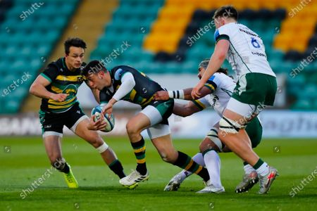 Alex Mitchell of Northampton Saints looks to offload to Tom Collins; Franklin's Gardens, Northampton, East Midlands, England; Premiership Rugby Union, Northampton Saints versus London Irish.