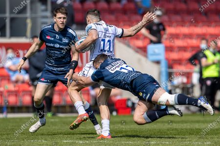 Jonny May of Gloucester Rugby is tackled by Rohan Janse van Rensburg of Sale Sharks; AJ Bell Stadium, Salford, Lancashire, England; English Premiership Rugby, Sale Sharks versus Gloucester.