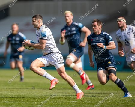 Stock Photo of Jonny May of Gloucester and England is pursued by AJ MacGinty of Sale Sharks; AJ Bell Stadium, Salford, Lancashire, England; English Premiership Rugby, Sale Sharks versus Gloucester.