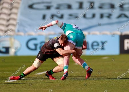 Captain Alex Dombrandt of Harlequins tackles Annett of Worcester warriors; Twickenham Stoop, London, England; English Premiership Rugby, Harlequins versus Worcester Warriors.