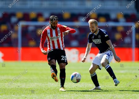 Saman Ghoddos of Brentford passing the ball into midfield as Billy Mitchell of Millwall closes; Brentford Community Stadium, London, England; English Football League Championship Football, Brentford FC versus Millwall.