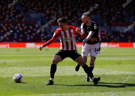 Sergi Canos of Brentford is challenged by Scott Malone of Millwall; Brentford Community Stadium, London, England; English Football League Championship Football, Brentford FC versus Millwall.