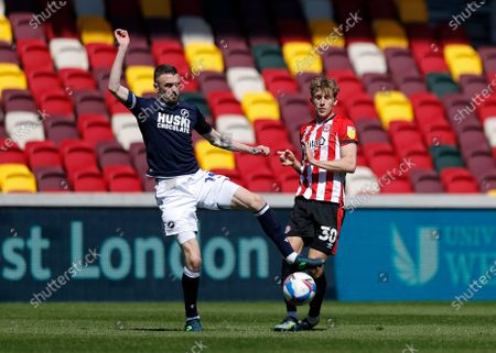Scott Malone of Millwall challenges Mads Roerslev of Brentford; Brentford Community Stadium, London, England; English Football League Championship Football, Brentford FC versus Millwall.