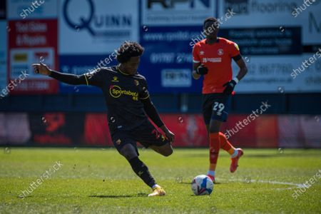 Stock Photo of Carlos Sanchez of Watford hits a long ball out to the wing; Kenilworth Road, Luton, Bedfordshire, England; English Football League Championship Football, Luton Town versus Watford.