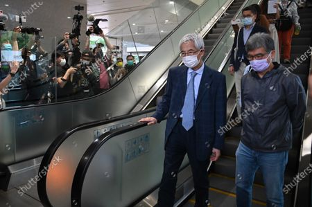 Stock Photo of Martin Lee rides down an escalator at West Kowloon Magistrates Court, after appearing at a court for sentencing in Hong Kong, Friday, April 16, 2021. Several pro-democracy activists are in court to receive sentencing after being found guilty of organizing an unauthorised assembly on August 18, 2019.