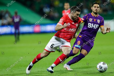 Perth Glory player Bruno Fornaroli beaten for pace by Wellington Phoenix FC player Tim Payne; HBF Park, Perth, Western Australia, Australia; A League Football, Perth Glory versus Wellington Phoenix.