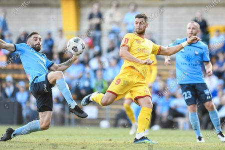 Stock Image of Tomi Juric of Adelaide United waits for the ball to drop and shoot as Anthony Caceres of Sydney intercepts; Leichardt Oval, Sydney, New South Wales, Australia; A League Football, Sydney Football Club versus Adelaide United.