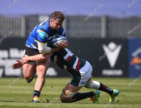 George Martin of Leicester Tigers tackles Will Stuart of Bath; 18th April 2021 2021; Recreation Ground, Bath, Somerset, England; English Premiership Rugby, Bath versus Leicester Tigers.
