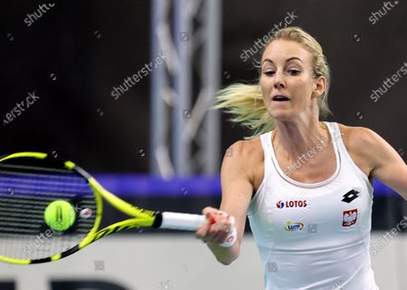 Polish tennis player Urszula Radwanska in action during her sinlges match against Brazil tennis player Laura Pigossi for the Billy Jean King Cup play-off tie between Poland and Brazil, in Bytom, south Poland, 16 April 2021.