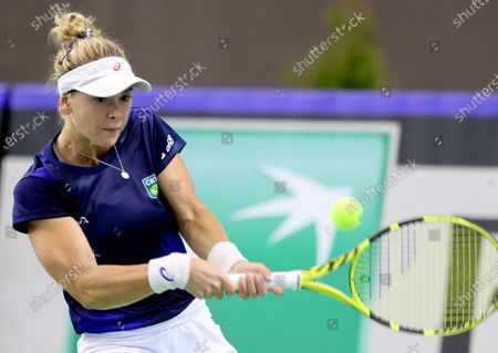 Brazilian tennis player Laura Pigossi in action during her sinlges match against Polish tennis player Urszula Radwanska for the Billy Jean King Cup play-off tie between Poland and Brazil, in Bytom, south Poland, 16 April 2021.