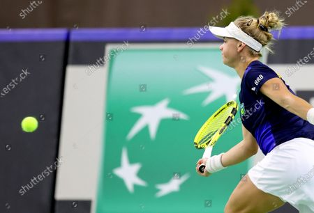 Stock Image of Brazilian tennis player Laura Pigossi in action during her sinlges match against Polish tennis player Urszula Radwanska for the Billy Jean King Cup play-off tie between Poland and Brazil, in Bytom, south Poland, 16 April 2021.