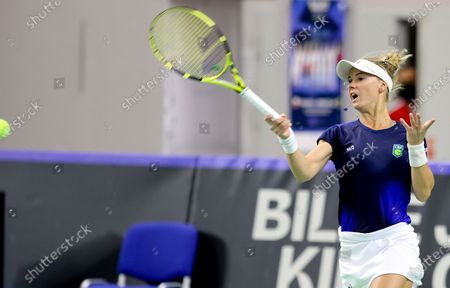 Stock Photo of Brazilian tennis player Laura Pigossi in action during her sinlges match against Polish tennis player Urszula Radwanska for the Billy Jean King Cup play-off tie between Poland and Brazil, in Bytom, south Poland, 16 April 2021.