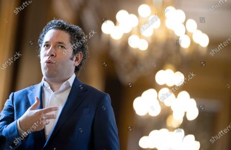 Stock Photo of Venezuelan conductor Gustavo Dudamel speaks to media after holding a news conference in Paris, France, 16 April 2021. Dudamel was appointed as the new music director of the Paris Opera house.