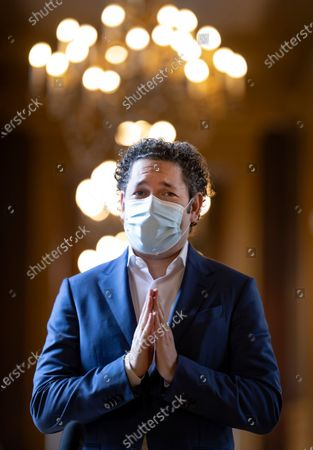 Stock Image of Venezuelan conductor Gustavo Dudamel gestures after holding a news conference in Paris, France, 16 April 2021. Dudamel was appointed as the new music director of the Paris Opera house.