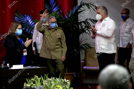 Army General Raul Castro Ruz (C), First Secretary of the Central Committee of the Communist Party of Cuba (CC PCC), is applauded by Cuban President Miguel Diaz-Canel Bermudez (R) and the VIII Congress of the Communist Party of Cuba in Havana, Cuba, 16 April 2021. Castro is stepping down as the leader of the party.