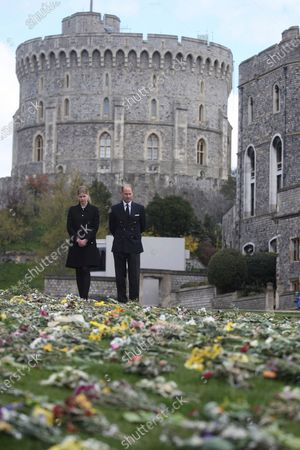Britain's Prince Edward Lady Louise Windsor view flowers outside St George's Chapel, at Windsor Castle, Windsor England, ahead of the Saturday funeral service for Britain's Prince Philip. Prince Philip died at the age of 99 on April 9
