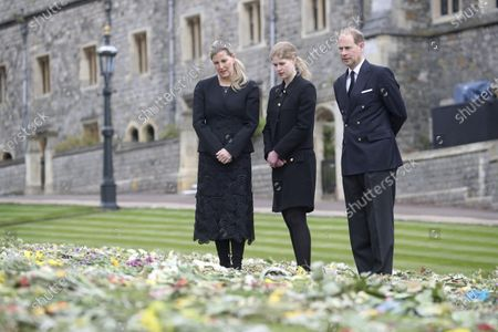 Britain's Prince Edward, Lady Louise Windsor and Sophie Countess of Wessex, right to left, view flowers outside St George's Chapel, at Windsor Castle, Windsor England, ahead of the Saturday funeral service for Britain's Prince Philip. Prince Philip died at the age of 99 on April 9