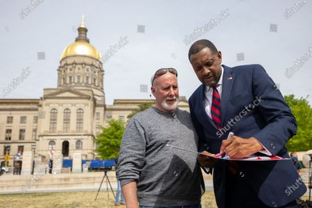 Former State Rep. Vernon Jones talks with supporters and media after his campaign announcement for Georgia Governor in front of the state capitol in Atlanta, Georgia on April 16th, 2021.