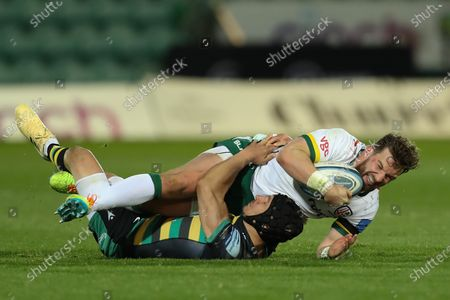 James Stokes of London Irish is brought to ground by Fraser Dingwall of Northampton Saints