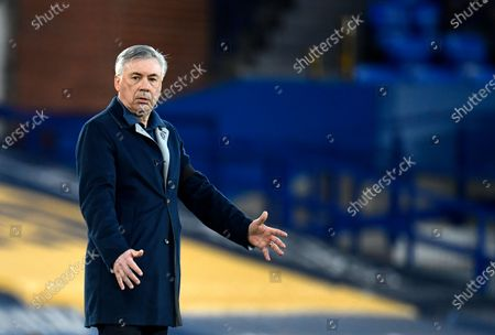 Stock Picture of Everton's manager Carlo Ancelotti gives instructions to his players during the English Premier League soccer match between Everton and Tottenham Hotspur at Goodison Park in Liverpool, England