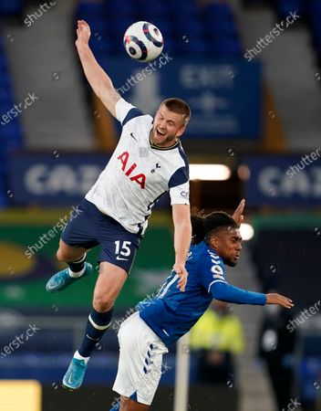 Tottenham's Eric Dier, left, duels for the ball with Everton's Alex Iwobi during the English Premier League soccer match between Everton and Tottenham Hotspur at Goodison Park in Liverpool, England
