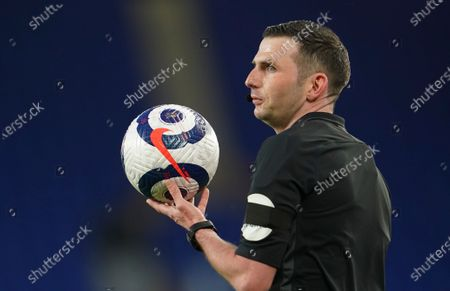 Referee Michael Oliver looks out during the English Premier League soccer match between Everton and Tottenham Hotspur at Goodison Park in Liverpool, England