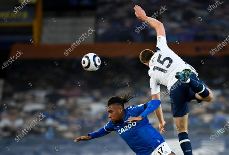Everton's Alex Iwobi, left, duels for the ball with Tottenham's Eric Dier during the English Premier League soccer match between Everton and Tottenham Hotspur at Goodison Park in Liverpool, England