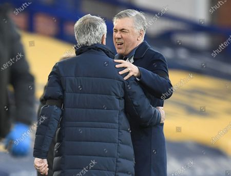 Tottenham's manager Jose Mourinho (L) greets Everton's manager Carlo Ancelotti (R) before the English Premier League soccer match between Everton FC and Tottenham Hotspur in Liverpool, Britain, 16 April 2021.