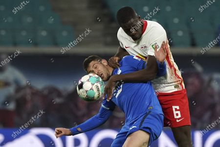 Stock Image of Hoffenheim's Andrej Kramaric, left, challenges for the ball with Leipzig's Ibrahima Konate during the German Bundesliga soccer match between RB Leipzig and TSG 1899 Hoffenheim in Leipzig, Germany
