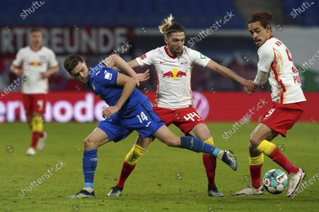 Hoffenheim's Christoph Baumgartner, left, challenges for the ball with Leipzig's Kevin Kampl, center and Yussuf Poulsen, right, during the German Bundesliga soccer match between RB Leipzig and TSG 1899 Hoffenheim in Leipzig, Germany
