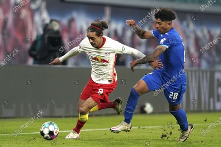 Hoffenheim's Chris Richards, right, challenges for the ball with Leipzig's Yussuf Poulsen, left, during the German Bundesliga soccer match between RB Leipzig and TSG 1899 Hoffenheim in Leipzig, Germany