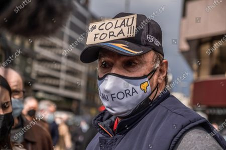 A protester seen with a placard on his hat calling for the resignation of Mayor Ada Colau during the demonstration.Around 300 people summoned by different civic entities have demonstrated through the streets of Barcelona to the door of the City Hall to request the resignation of the mayor of Barcelona Ada Colau and to show rejection of the municipal policies of urban development and security.