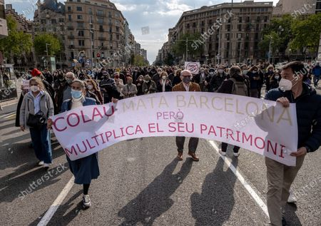 Protesters hold a banner with a slogan Colau kills Barcelona but multiplies her heritage during the demonstration.Around 300 people summoned by different civic entities have demonstrated through the streets of Barcelona to the door of the City Hall to request the resignation of the mayor of Barcelona Ada Colau and to show rejection of the municipal policies of urban development and security.