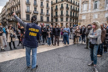 A protester is seen wearing a vest with a slogan of the demonstration Colau Resignation during the demonstration.Around 300 people summoned by different civic entities have demonstrated through the streets of Barcelona to the door of the City Hall to request the resignation of the mayor of Barcelona Ada Colau and to show rejection of the municipal policies of urban development and security.