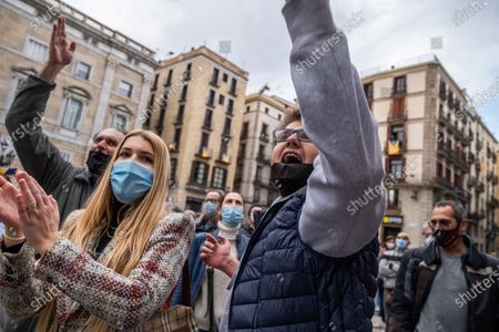 Protesters chant slogans during the demonstration in Plaza Sant Jaume.Around 300 people summoned by different civic entities have demonstrated through the streets of Barcelona to the door of the City Hall to request the resignation of the mayor of Barcelona Ada Colau and to show rejection of the municipal policies of urban development and security.