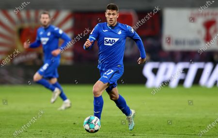 Stock Photo of Andrej Kramaric of TSG Hoffenheim controls the ball during the German Bundesliga soccer match between RB Leipzig and TSG Hoffenheim at Red Bull Arena in Leipzig, Germany, 16 April 2021.