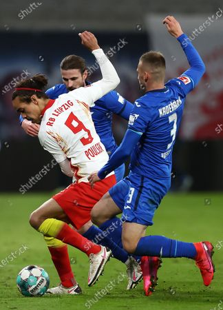 Yussuf Poulsen (L) of RB Leipzig battles for possession with Pavel Kaderabek of TSG 1899 Hoffenheim during the German Bundesliga soccer match between RB Leipzig and TSG Hoffenheim at Red Bull Arena in Leipzig, Germany, 16 April 2021.