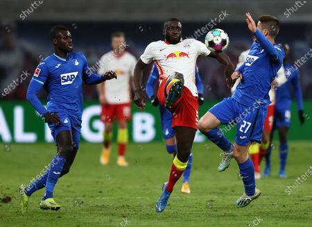 Dayot Upamecano (C) of RB Leipzig battles for possession with Chris Richards (L) and Andrej Kramaric of TSG 1899 Hoffenheim during the German Bundesliga soccer match between RB Leipzig and TSG Hoffenheim at Red Bull Arena in Leipzig, Germany, 16 April 2021.