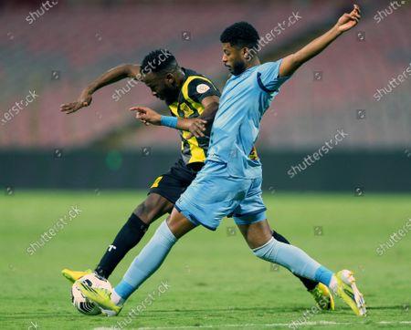 Al-Ittihad's player Fahad Al Muwallad (L) in action against Al-Batin's Hassan Mohammed Raghfawi (R) during the Saudi Professional League soccer match between Al-Ittihad and Al-Batin at King Abdulaziz Stadium, Mecca, Saudi Arabia, 16 April 2021.