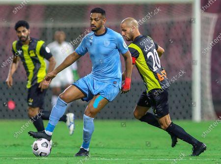 Al-Ittihad's player Karim El Ahmadi (R) in action against Al-Batin's Zakaria Al-Sudani (L) during the Saudi Professional League soccer match between Al-Ittihad and Al-Batin at King Abdulaziz Stadium, Mecca, Saudi Arabia, 16 April 2021.