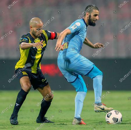 Stock Picture of Al-Ittihad's player Karim El Ahmadi (L) in action against Al-Batin's Youssef El Jebli (R) during the Saudi Professional League soccer match between Al-Ittihad and Al-Batin at King Abdulaziz Stadium, Mecca, Saudi Arabia, 16 April 2021.